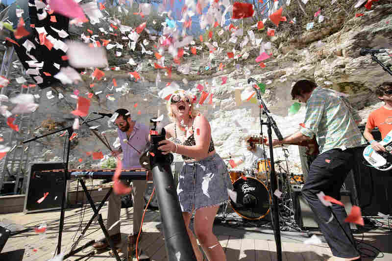 Calliope Musicals' Carrie Fussell mans the confetti cannon at Cheer Up Charlie's.