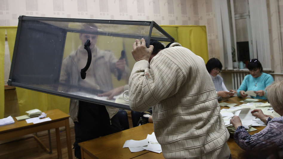 Election staff begin to count votes at a polling station in Bachchisaray, in Crimea, Ukraine, Sunday. Crimeans voted to decide whether the peninsula will break away from mainland Ukraine. The referendum has been dismissed as illegal by the West.