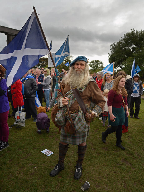 Pro-independence supporters, seen here at a September rally in Edinburgh, say many Scots still see the English as colonial empire-builders.