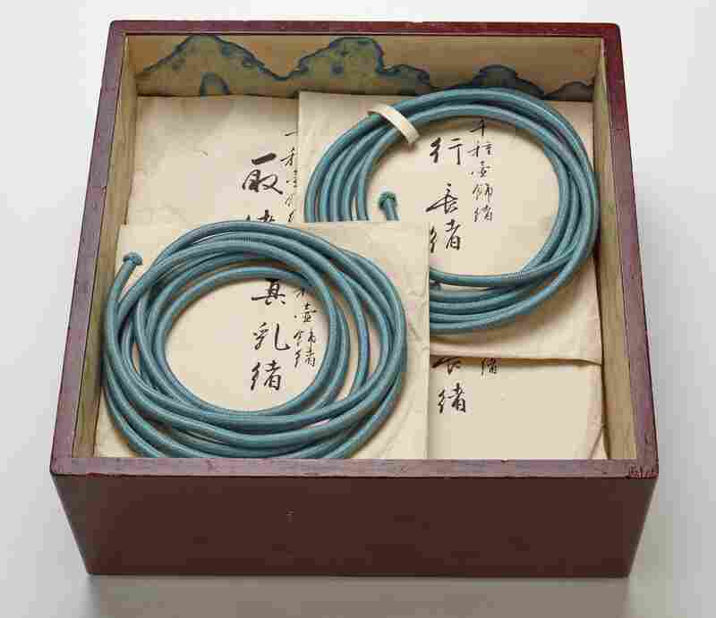A tray for Chigusa's inner storage box, with ornamental cords and storage envelopes.