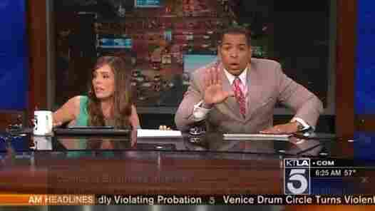 KTLA-TV anchors Megan Henderson, left, and Chris Schauble as they emerged from beneath