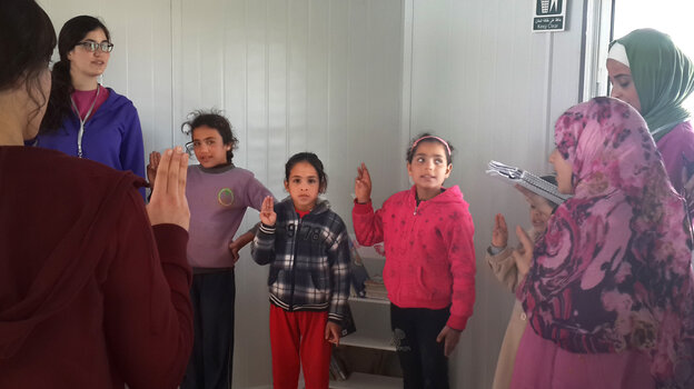 """An informal Girl Scout group at the Zaatari refugee camp in Jordan sings: """"We want to learn and rise up to fulfill our dreams."""""""