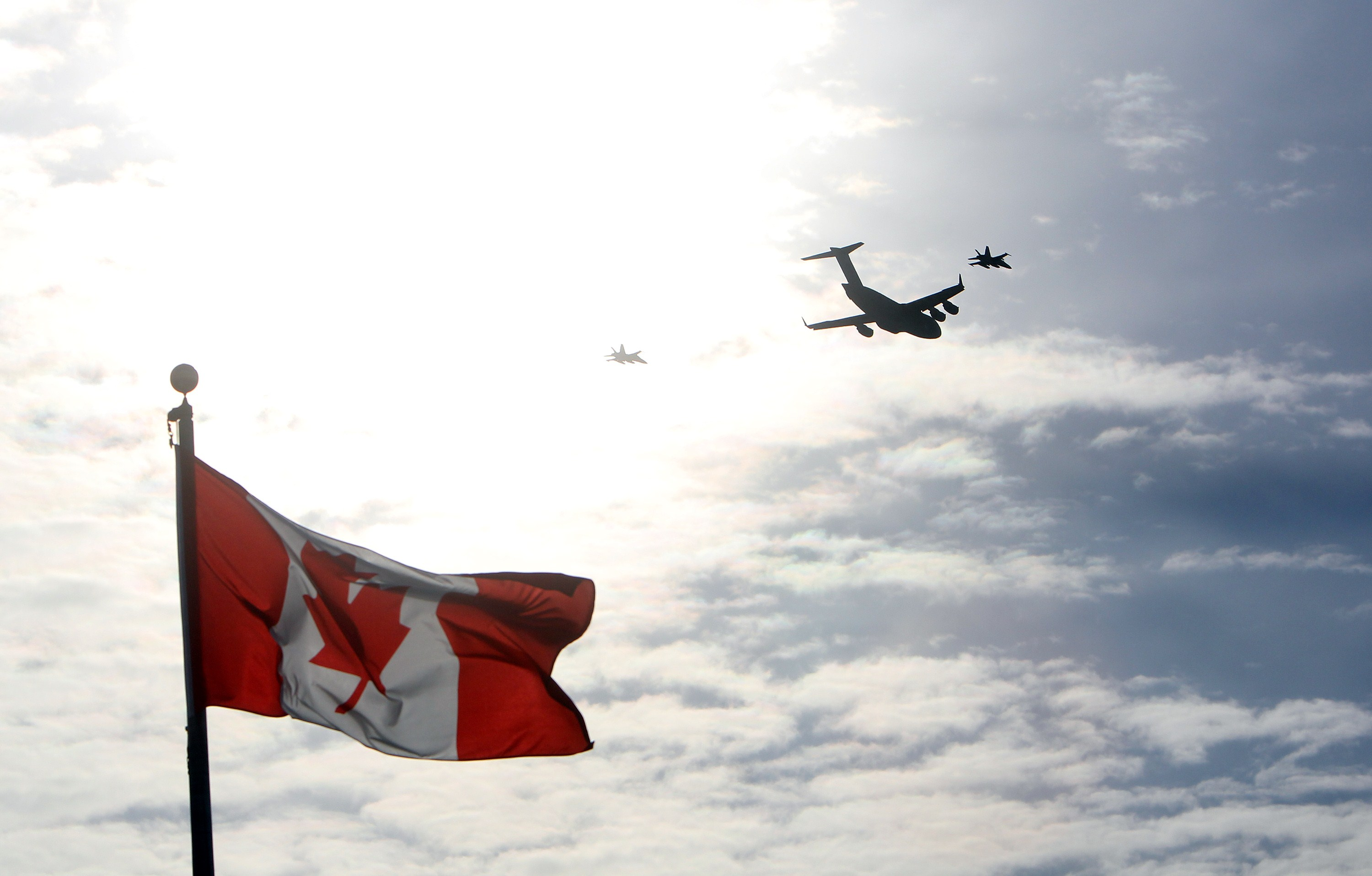 The plane carrying the last of Canada's troops in Afghanistan is escorted through the air by fighter jets.