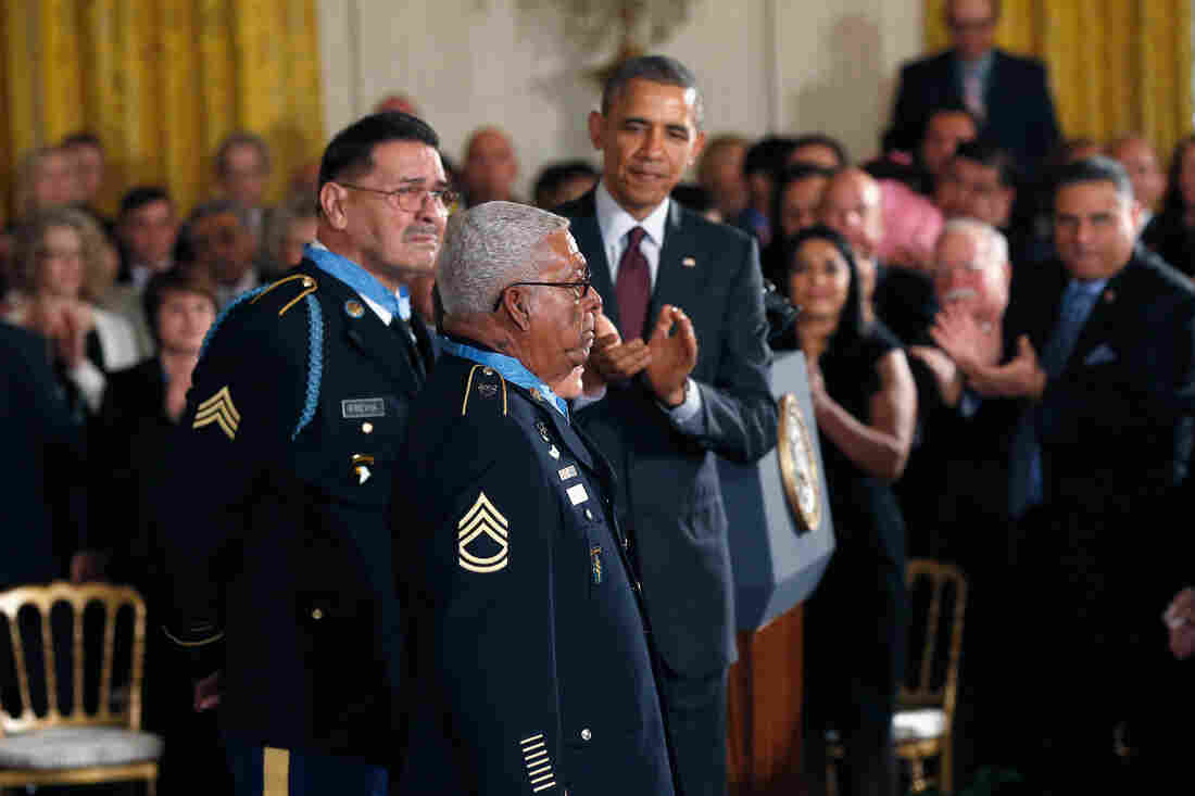 Vietnam veterans Melvin Morris (center), Jose Rodela (obscured) and Santiago J. Erevia (left) received the Medal of Honor from President Obama at the White House on Thursday.