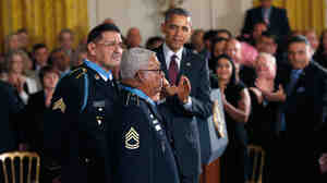 Vietnam veterans Melvin Morris (center), Jose Rodela (obscured) and Santiago J. Erevia (left) received the Medal of Honor from President Obama at the White House on
