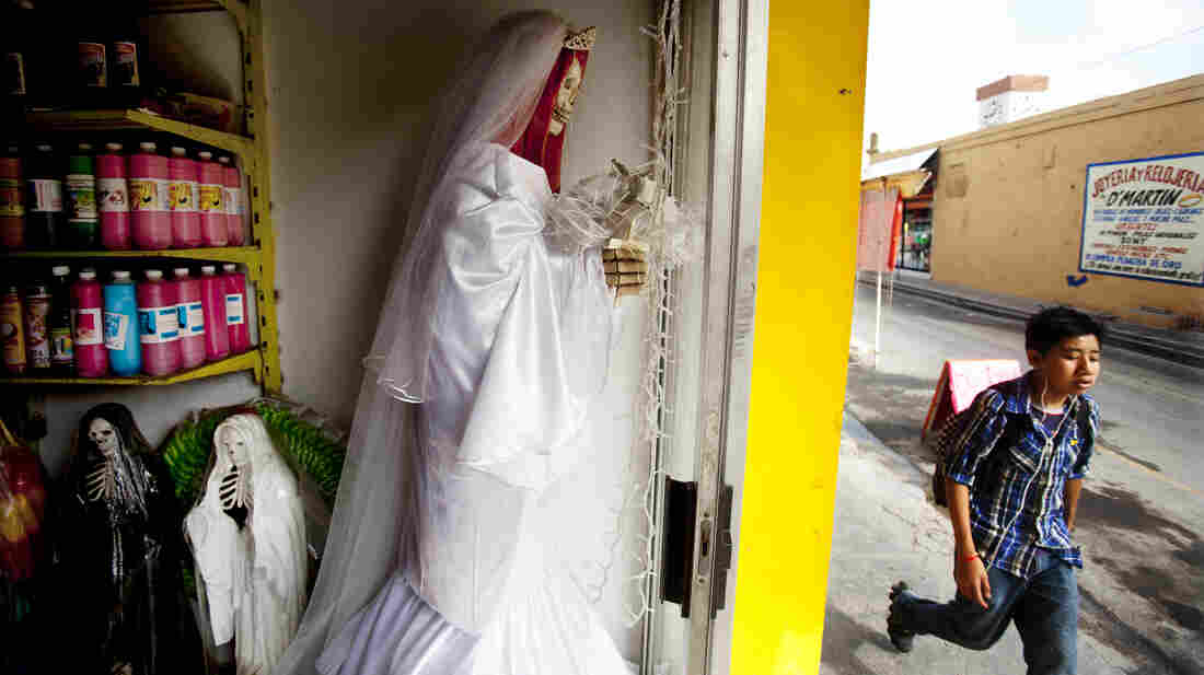 La Patrona, a botanica owned by Senora Tina in Matamoros, Mexico, sells statues, candles and mini figurines of Santa Muerte. Senora Tina says the cult of Saint Death is growing fast north of the border, where she has many clients who travel to Matamoros for consultations.