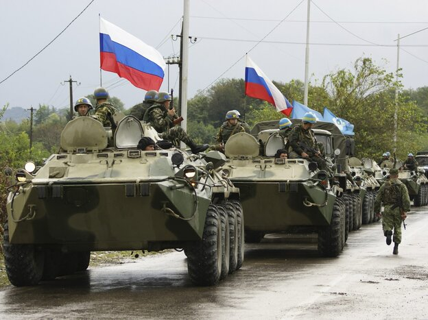 A column of Russian troops prepares to leave the checkpoint at a bridge over the Inguri River in Western Georgia, in October 2008, after securing the secession of Georgia's breakaway South Ossetia region.