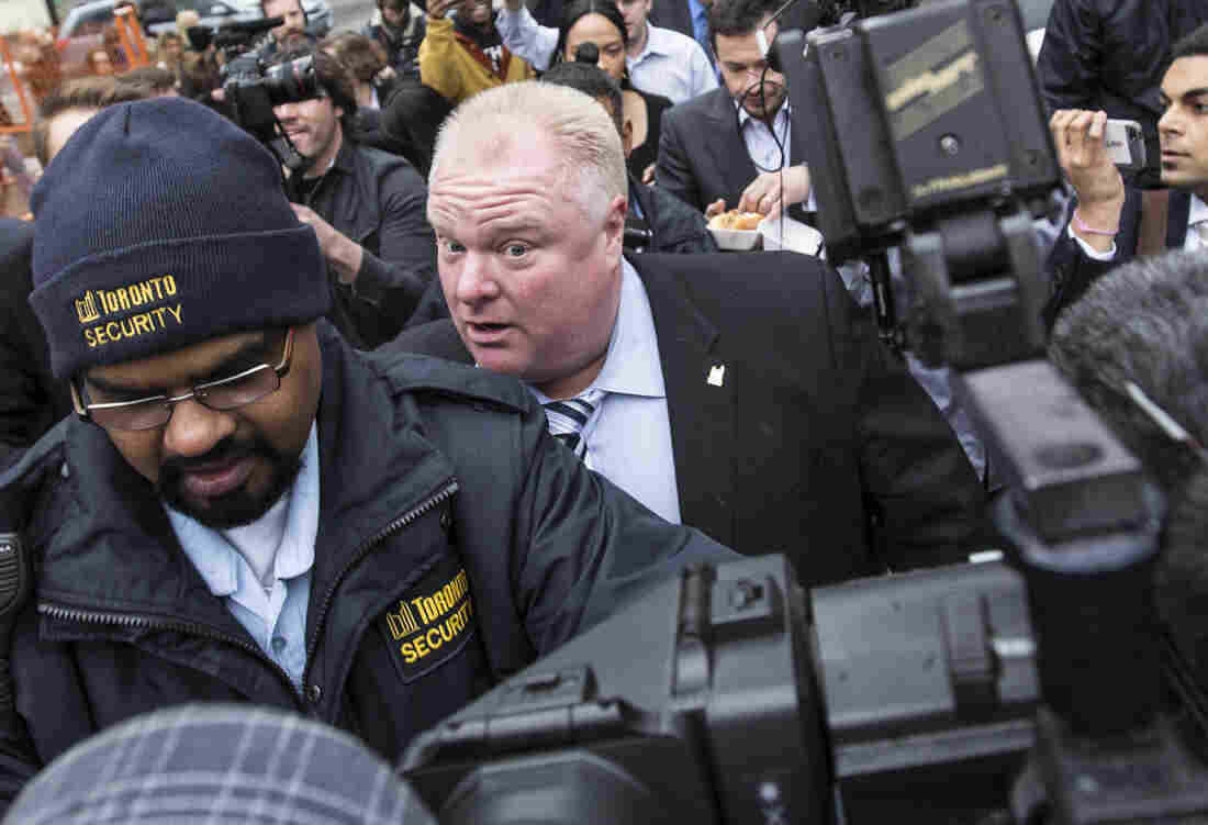 Toronto Mayor Rob Ford walks to City Hall in a media scrum in Toronto, on Wednesday.