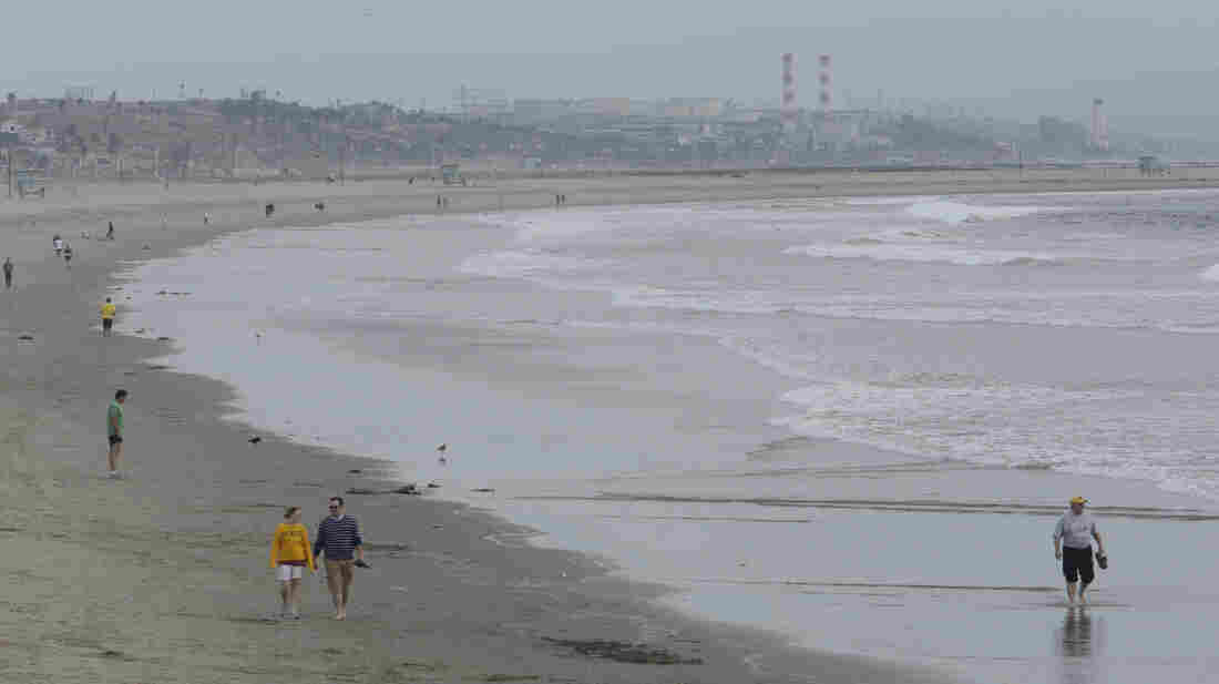 People walk along Venice Beach in Los Angeles. A new climate-focused U.S. government website will provide data on sea level rise and coastal flooding.