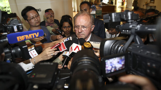 Jean-Paul Troadec (center), special adviser to France's aviation accident investigation bureau, speaks to journalists on Tuesday.