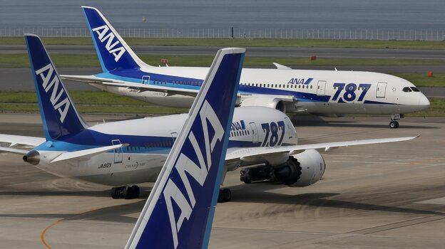 At Tokyo International Airport last July, Boeing 787 Dreamliners flown by All Nippon Airways taxied across the tarmac. (EPA/Landov)
