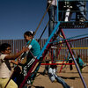 Children play near a border fence at the Escuela Primaria Federal Profesor Ramon Espinoza Villanueva, a primary school in Palomas, Mexico. Palomas borders Columbus, N.M., its sister village.