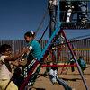 Children play near a border fence at the Escuela Primaria Federal Profesor Ramon Espinoza Villanueva, a primary school in Palomas, Mexico. Palomas borders Columbus, N.M., its sister village.