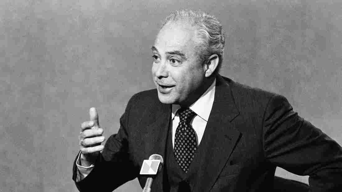 Robert Strauss speaks with interviewers before a broadcast of NBC's Meet the Press in 1979. The former chairman for the Democratic National Committee died Wednesday at the age of 95.