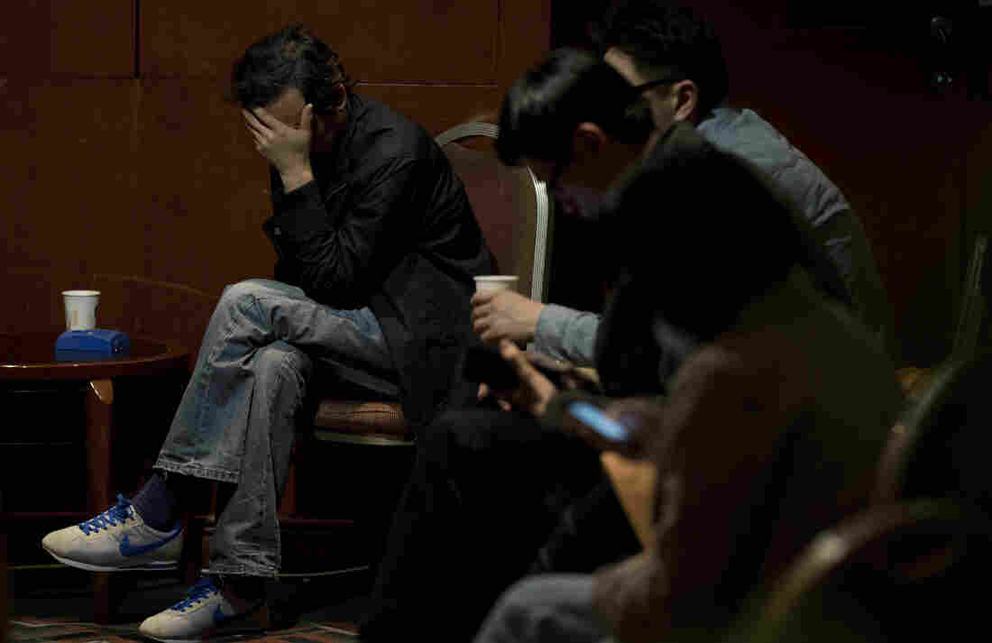 Relatives of the Chinese passengers aboard the missing Malaysia Airlines Flight 370 wait for the latest news of the plane at a Beijing hotel on Thursday.