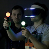 Marcus Ingvarsson (right)  tests out the PlayStation 4 virtual reality headset Project Morpheus in a demo area at the Game Developers Conference 2014 in San Francisco on Wednesday.