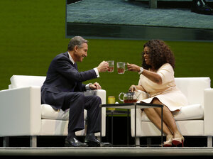 Howard Schultz, left, chairman and CEO of Starbucks Coffee Company, clinks tea cups with Oprah Winfrey, right, to announce their partnership to offer Teavana Oprah Chai tea.