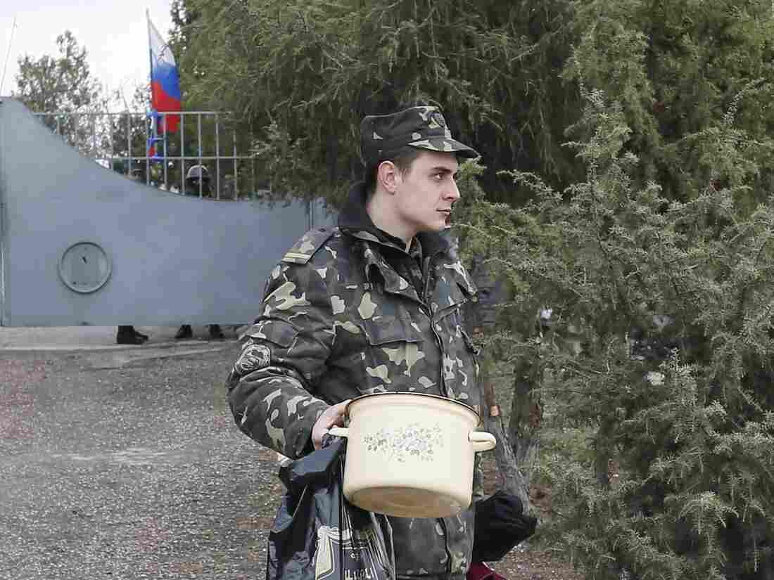 A Russian flag flies behind him Thursday as a Ukrain