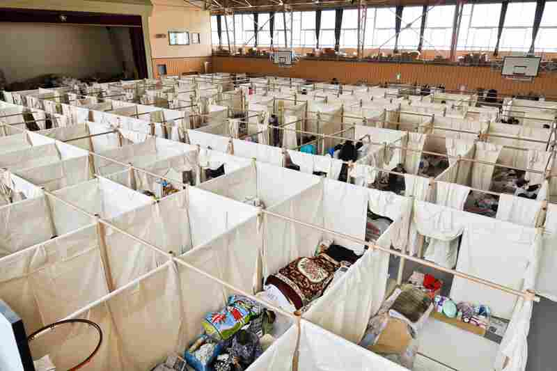 Ban developed a paper partition system — like this one in Japan in 2011 — to give evacuees privacy in crowded shelters.