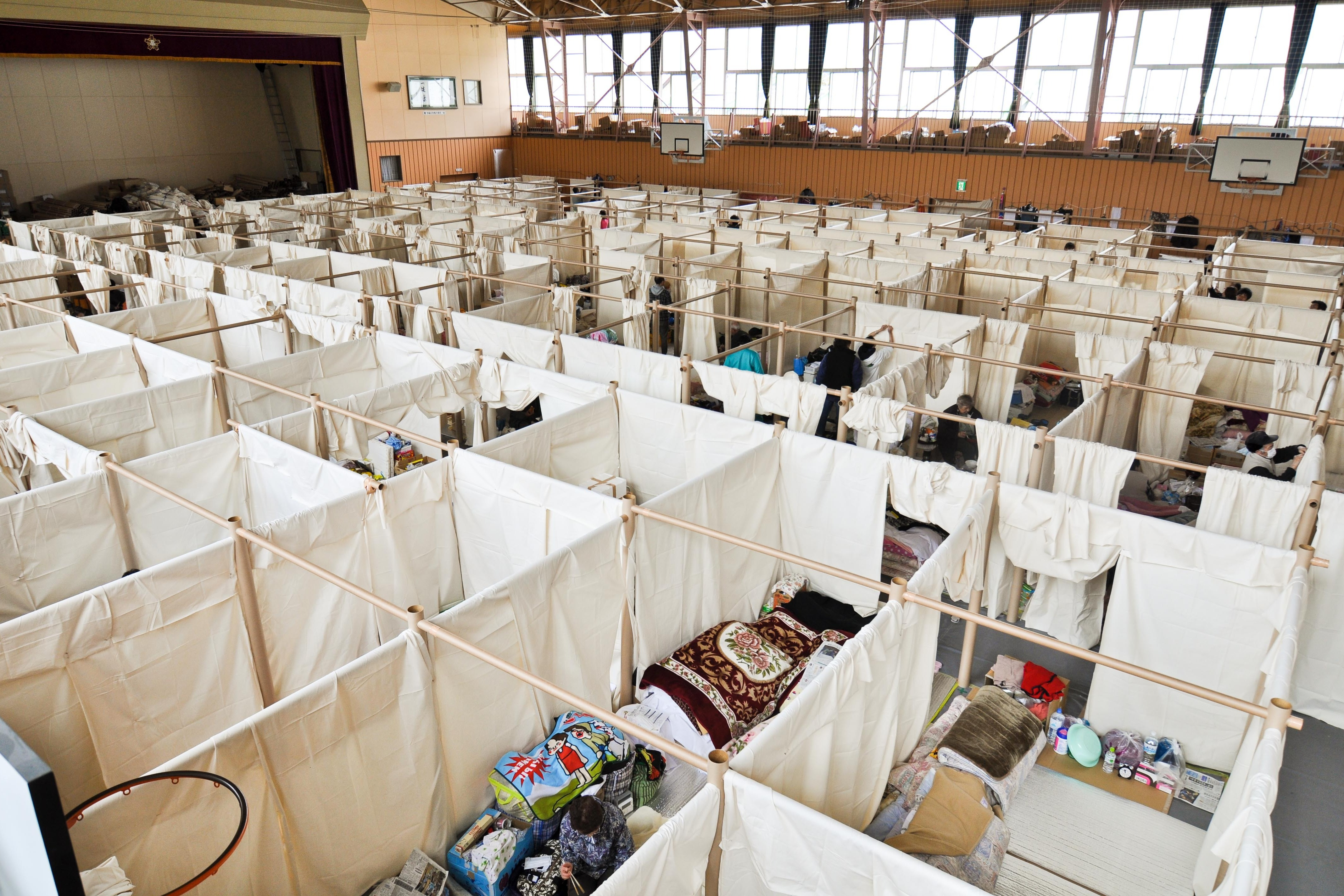 Ban developed a paper partition system -- like this one in Japan in 2011 -- to give evacuees privacy in crowded shelters.