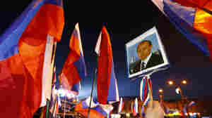 A woman holds a portrait of Russia's President Vladimir Putin during celebrations on the main square of the Crimean city of Simferopol after in its official annexation on Friday.