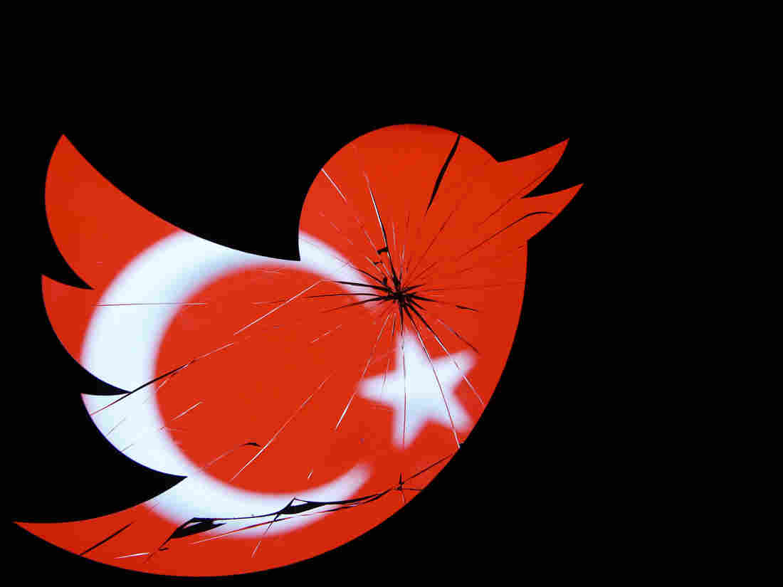 A Turkish national flag is seen through a broken Twitter logo in this photo illustration Friday.