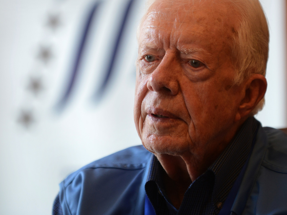 """Jimmy Carter's other books include <a href=""""http://www.npr.org/books/titles/137944084/palestine-peace-not-apartheid"""">Palestine Peace Not Apartheid</a>, <a href=""""http://www.npr.org/books/titles/138426891/sharing-good-times"""">Sharing Good Times</a> and <a href=""""http://www.npr.org/books/titles/138386988/our-endangered-values-americas-moral-crisis"""">Our Endangered Values</a>. (Prakash Methema/AFP/Getty Images)"""