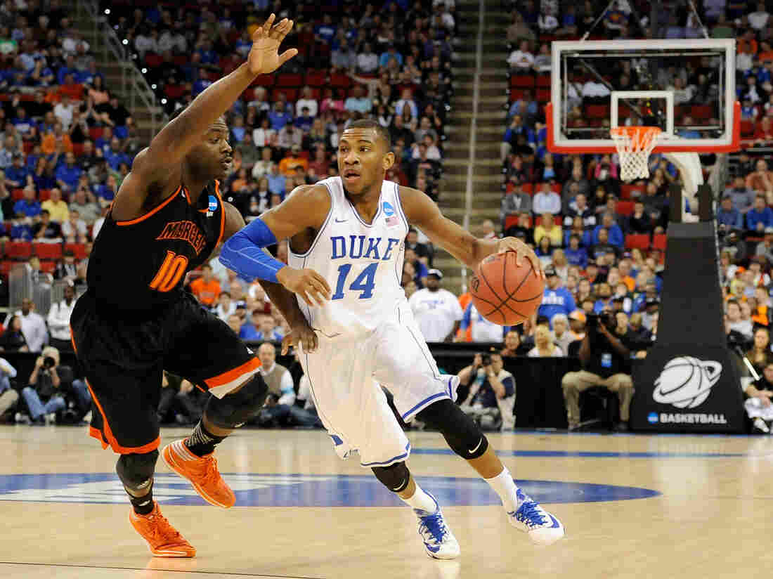 Duke's Rasheed Sulaimon drives to the basket against Mercer's Ike Nwamu.