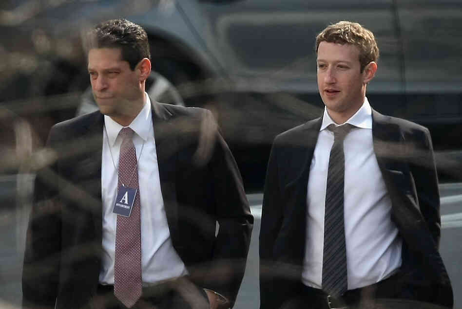 Facebook CEO Mark Zuckerberg, right, arrives at the White House for an Oval Office meeting with President Obama on Friday in Washington, DC.