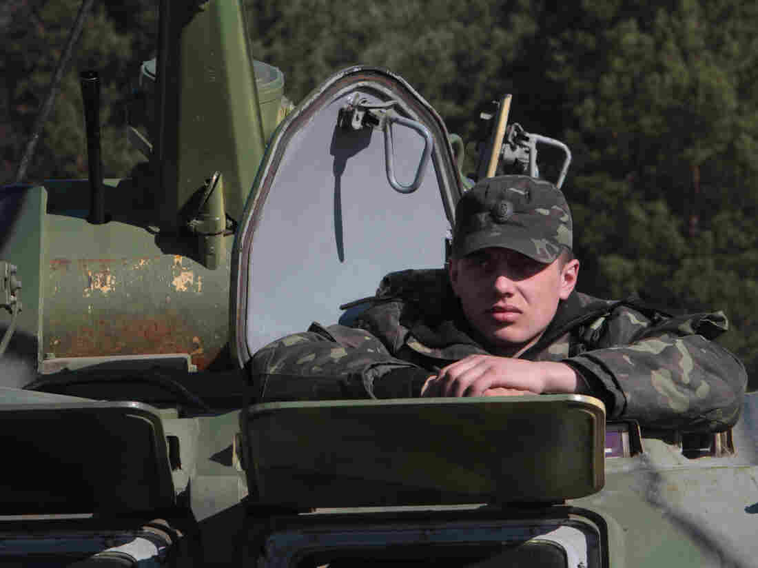 Ukrainian soldier sits in a tank during a military exercise near Goncharovsk village of the Chernigov area in Ukraine on March 14, 2014. Russian troops have gathered near the Ukraine border for exercises as the standoff continues over Crimea.