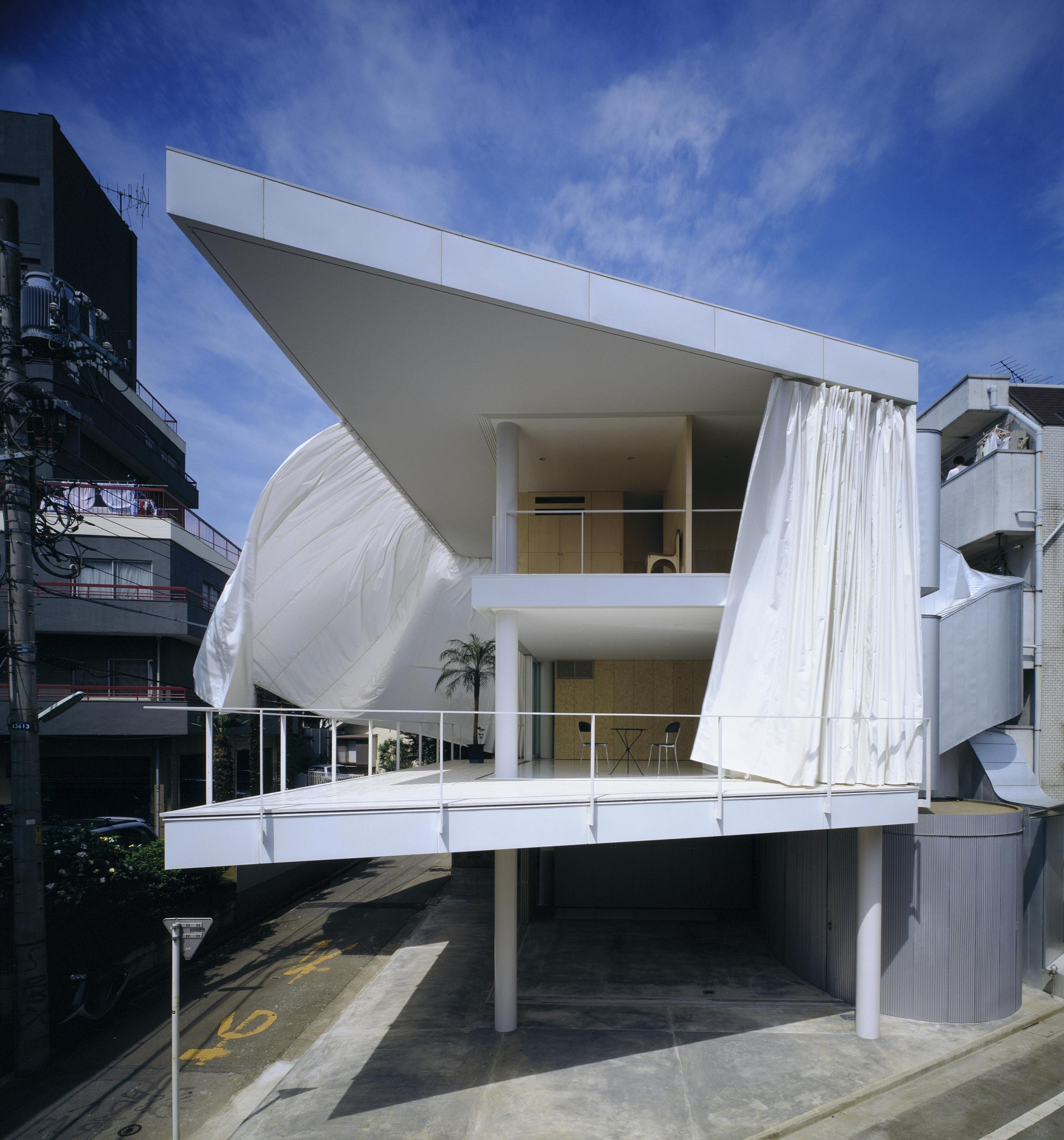 "The Pritzker jury cites the continuity Ban creates between interior and exterior spaces. His 1995 Curtain Wall House in Tokyo ""uses tent-like movable curtains to easily link interior and exterior, yet provide privacy when needed."""