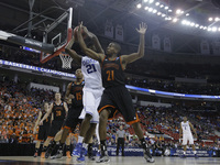 Duke forward Amile Jefferson, in white, and Mercer guard Langston Hall battle for the ball during Friday's game.