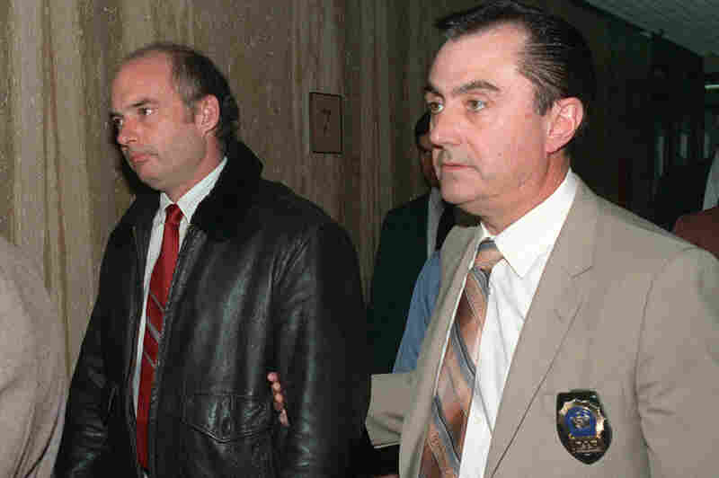 In March 1989, former Exxon Valdez Capt. Joseph Hazelwood is escorted to his arraignment inside Suffolk County courthouse on charges stemming from the spill.