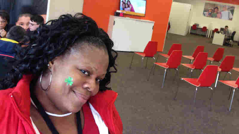 DeLisa Tolson signed up for health insurance at a retail store set up by Connecticut's exchange.  She says she was so happy with the experience, she told all her friends.