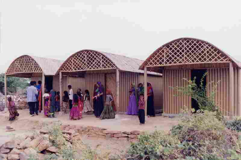 """In Bhuj, India, in 2001, Ban used rubble from destroyed buildings as the foundation for his Paper Log Houses. The roof --€"""" made of bamboo ribs, plastic tarpaulin and a woven cane mat — """" allowed ventilation for indoor cooking."""