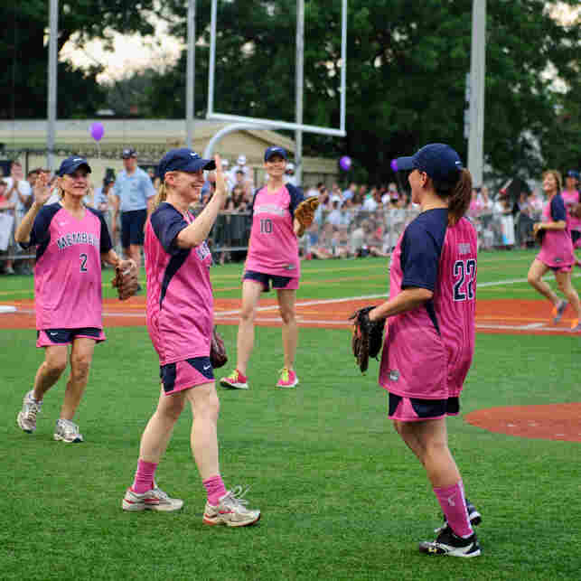 Sen. Kristen Gillibrand, D-N.Y., high-fives her teammate Rep. Martha Roby, R-Ala. during the annual Women's Congressional Softball Game last June.