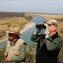 Dob Cunningham (left) and his friend Larry Johnson look over the edge of Cunningham's 800-acre ranch in