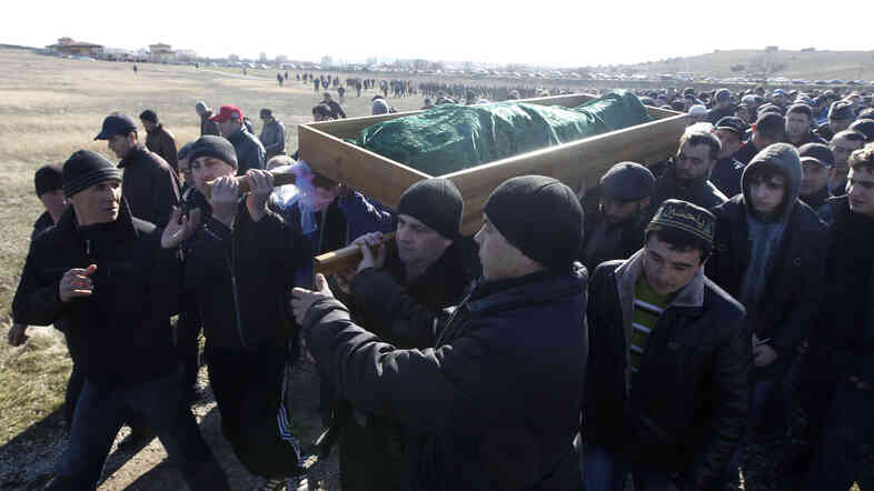 Crimean Tatars carry the body of Reshat Ametov during his funeral outside the town of Simferopol on Tuesday.