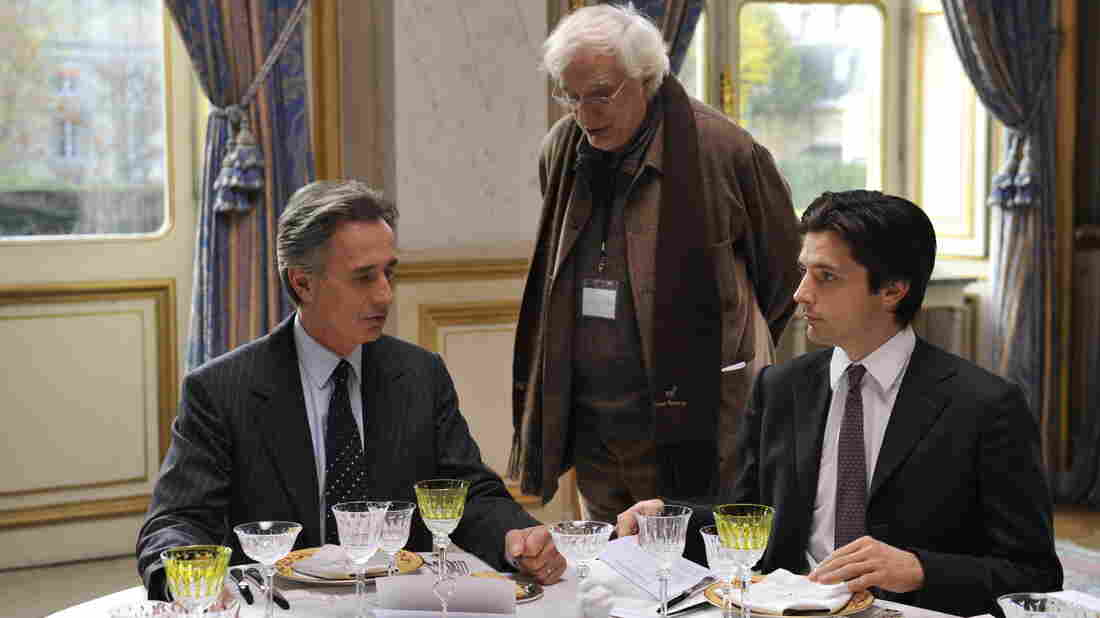Director Bertrand Tavernier (center) with Thierry Lhermitte and Raphael Personnaz on the set of The French Minister, a comedy about a dervish of a diplomat trying to head off a war.