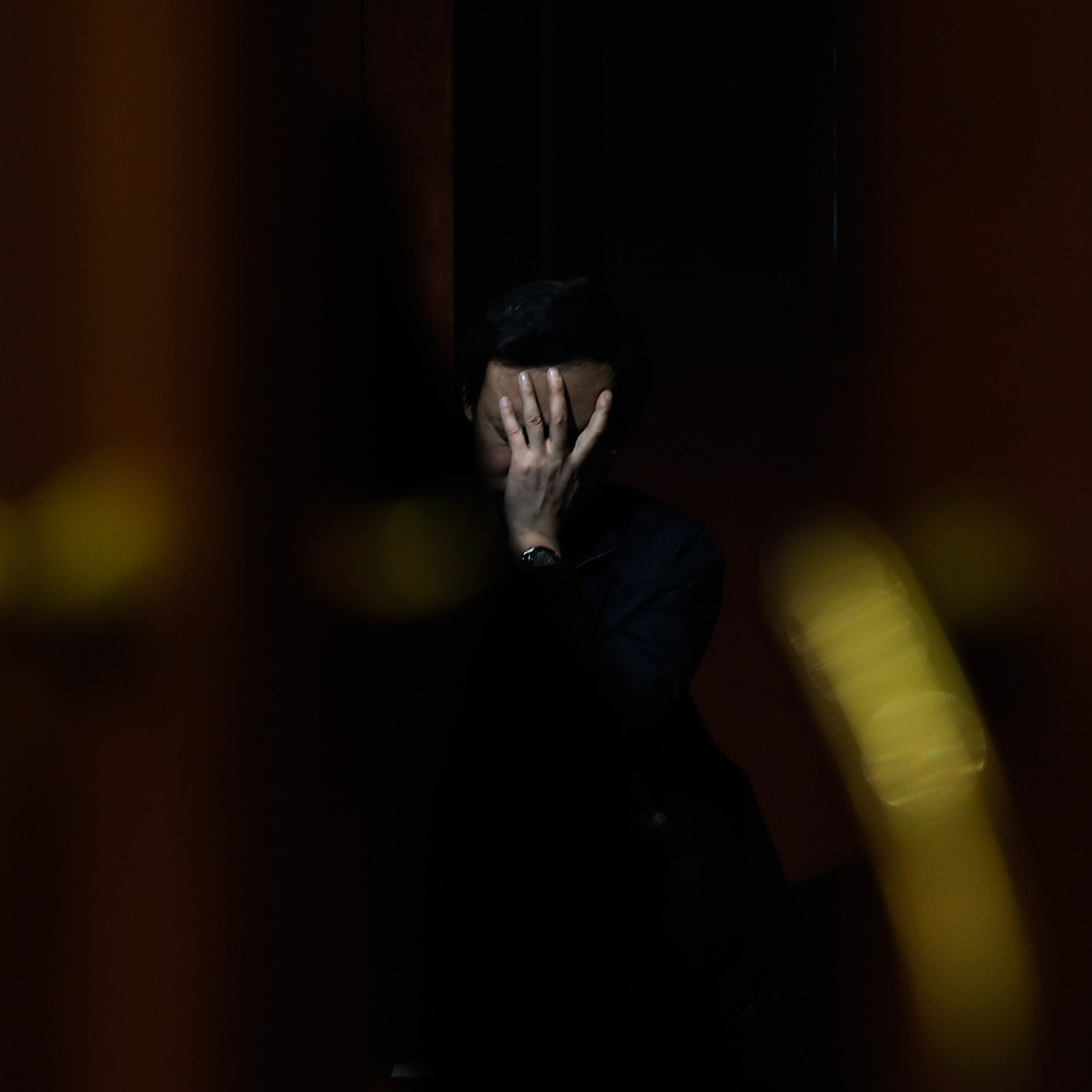 A family member of a passenger from the missing Malaysia Airlines flight MH370 waits for news at the Lido Hotel on Saturday in Beijing.