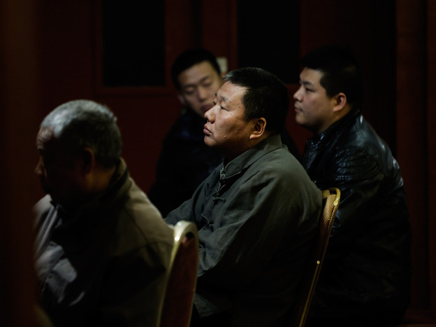 Chinese relatives of the passengers onboard Malaysia Airlines flight MH370 wait for the latest information at Lido Hotel Sunday in Beijing, China.