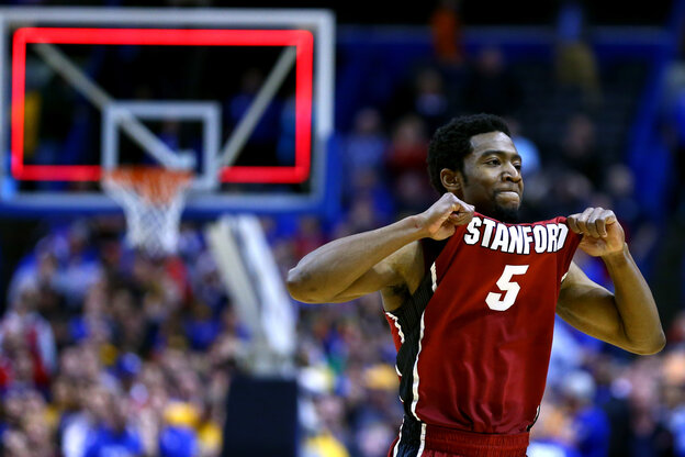 Chasson Randle of Stanford celebrates defeating the Kansas Jayhawks during the third round of the 2014 NCAA Men's