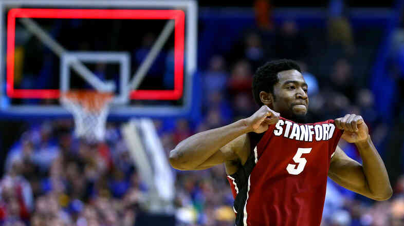 Chasson Randle of Stanford celebrates defeating the Kansas Jayhawks during the third round of the 2014 NCAA Men's Basketball Tournament.