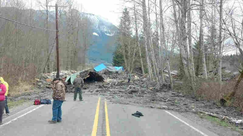 This photo provided by the Washington State Patrol shows the aftermath of a mudslide that moved a house with people inside in Snohomish County in Washington State on Saturday.