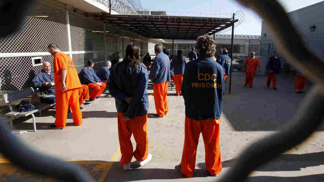 """Inmates in a recreation yard at the Deuel Vocational Institution in Tracy, Calif. California is trying to address court-ordered reductions in overcrowding with a plan to shift thousands of those convicted of """"nonserious"""" crimes to county jails."""