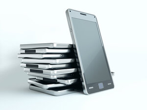 One way to avoid checking your phone at mealtime? Stack 'em up in the middle of the table.