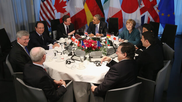 President Obama and other leaders met in The Hague. Clockwise from bottom left: European Union Council President Herman Van Rompuy, Canadian Prime Minister Stephen Harper, French President Francois Hollande, British Prime Minister David Cameron, Obama, German Chancellor Angela Merkel, Japanese Prime Minister Shinzo Abe, Italian Prime Minister Matteo Renzi and EU President Jose Manuel Barroso.
