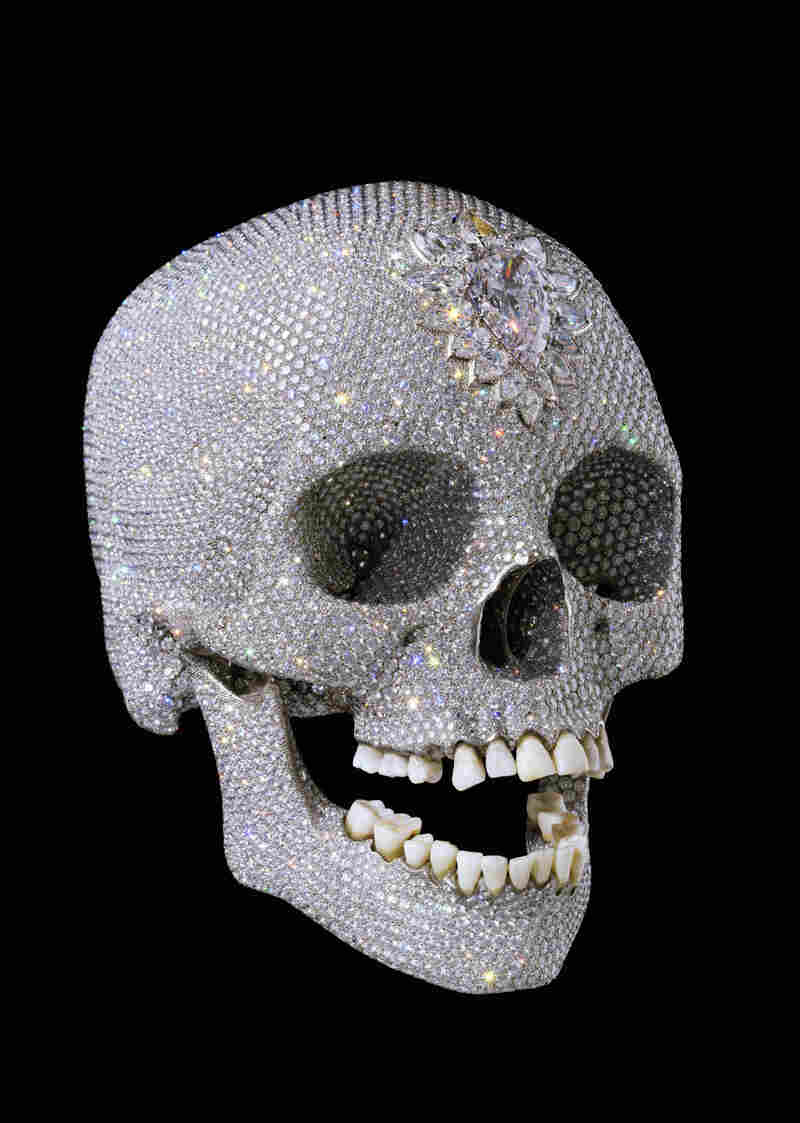 For the Love of God, by British artist Damien Hirst, shows a diamond-encrusted human skull and was unveiled in 2007.