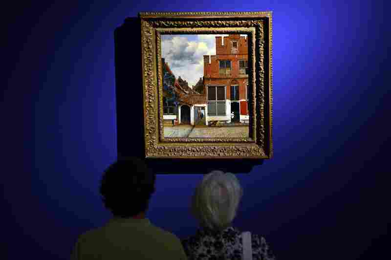 Visitors look at The Little Street by Dutch artist Johannes Vermeer.