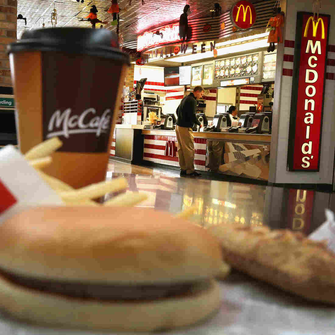 """Customers order food from a McDonald's restaurant in Des Plaines, Ill. The company has promised to start buying """"verified sustainable beef"""" in 2016."""